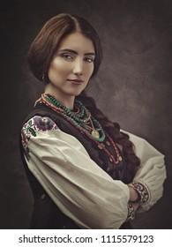 Ethno Beauty. Beautiful young woman in traditional ukrainian dress and bijou