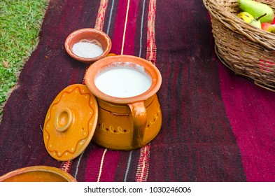 Ethno Ceramic bowl and sower milk on traditional rug