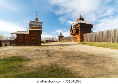 """Ethnographic open-air museum """"Taltsy"""". Wooden architecture Russia. Ancient buildings. Russian village on a beautiful sunny summer day against a blue sky with white clouds. Ancient buildings."""