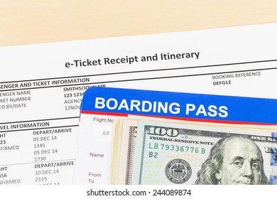 E-ticket with banknote, and boarding pass
