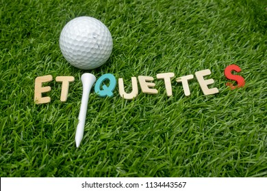 Etiquette word with golf ball and tee is on green grass