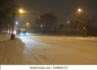 Etobicoke, Toronto, Ontario / Canada - Janury 28 2019: Mississauga bus driving on Bloor St. W during snowstorm in Toronto, Ontario.