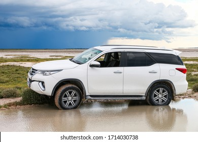 Etosha National Park, Namibia - February 7, 2020: Offroad car Toyota Fortuner in an African savanna.