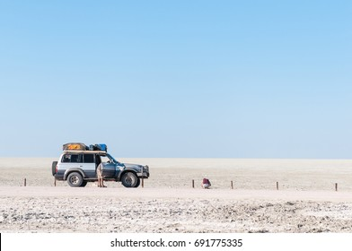 ETOSHA NATIONAL PARK, NAMIBIA - JUNE 21, 2017: Unidentified tourists at the viewpoint on the Etosha Pan in the Etosha National Park, Namibia