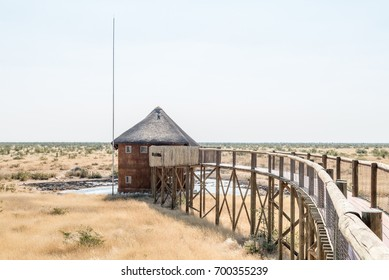 ETOSHA NATIONAL PARK, NAMIBIA - JUNE 26, 2017: The elevated walkway and hide at the waterhole at the Olifantsrus Rest Camp in the Etosha National Park