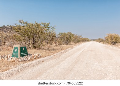 ETOSHA NATIONAL PARK, NAMIBIA - JUNE 27, 2017: A distance marker at the Rateldraf turn-off in the Western part of the Etosha National Park in Namibia