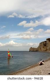 etretat beach with catamaran
