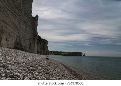Etretat is a commune in northern France and belongs to the department Seine-Maritime, located in the Normandy. It is well known for its chalk cliffs, incl. 3 natural arches (i.e. Elephant Cliff)