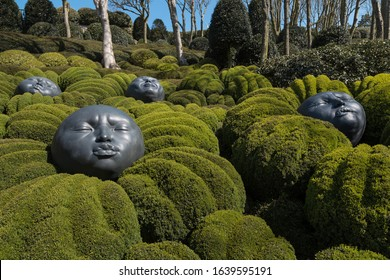 ETRETAT, FRANCE - APRIL 11, 2019: Art installation 'Drops of Rain' - giant rubber heads expressing various emotions in park Les Jardins d'Etretat, Normandy, France