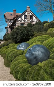 ETRETAT, FRANCE - APRIL 11, 2019: Historic villa Roxelane and art installation 'Drops of Rain' in park Les Jardins d'Etretat, Normandy, France. Vertical shot