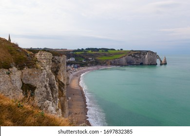 Etretat, Seine-Maritime, Normandie / France - OCTOBER 14, 2018: Etretat is best known for its chalk cliffs, which include natural arches, monolithic formations and its rocky beach.
