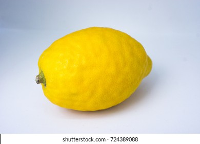 Etrog is the yellow citron or Citrus medica used by Jewish people during the week-long holiday of Sukkot, as one of the four species.  isolated image