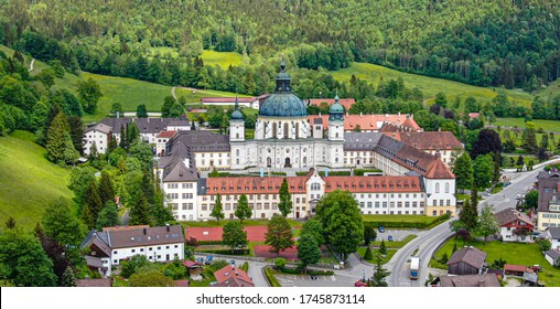 Ettal Abbey, called Kloster Ettal, a monastery in the village of Ettal, Bavaria, Germany - aerial photography