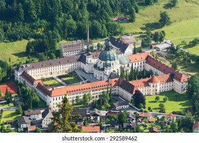 Ettal Abbey (Kloster Ettal), a Benedictine monastery in the village of Ettal close to Oberammergau, photographed from the Ochsensitz, a peak close to it, Ettal, Bavaria, Germany