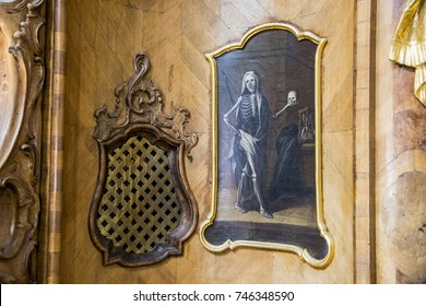 ETTAL, GERMANY - August 4, 2017: Allegory of death painted in a confessional, with a skeleton holding a skull. Ettal Abbey, Germany