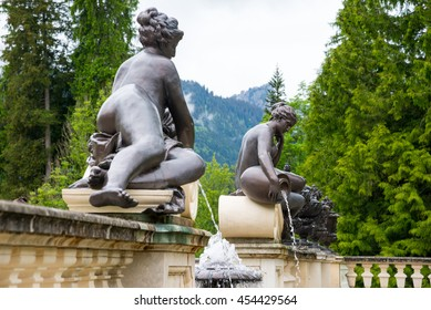 ETTAL, GERMANY - JUNE 5, 2016: Sculpture of nymph in Linderhof Palace park, Bavaria, Germany