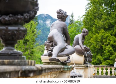 Ettal, Germany - June 5, 2016: Black sculpture of nymph in Linderhof Palace park, Bavaria, Germany