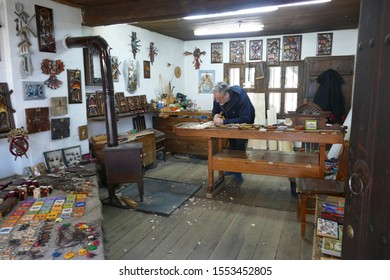 ETURA, BULGARIA - APR 16, 2019 - Carpenter making wood carving in the Ethnographic village, Etura, Gabravo, Bulgaria