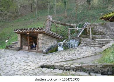ETURA, BULGARIA - APR 16, 2019 - Water wheel powers 19th century light industry in Ethnographic village, Etura, Gabravo, Bulgaria