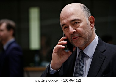 EU Commissioner for Economic and Financial Affairs, Taxation and Customs Pierre Moscovici uses his mobile phone prior to an Economic and Financial Affairs meeting in Brussels on January 23, 2018.