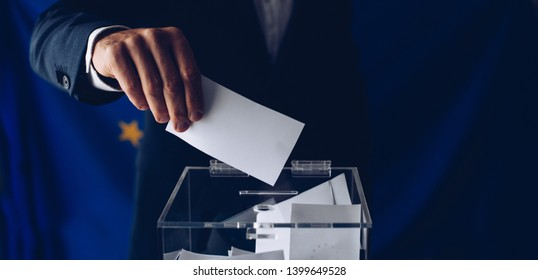 EU elections. Man throwing his vote into the ballot box. Elections to the European Parliament
