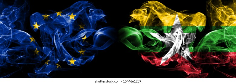 Eu, European union vs Myanmar smoke flags placed side by side. Thick colored silky smokes abstract flags