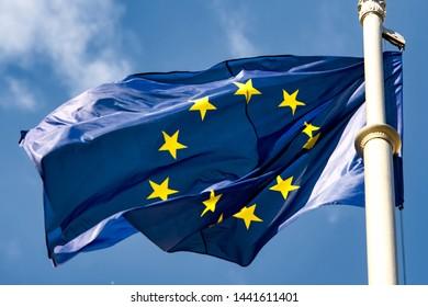 EU flag against a blue sky.