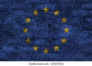 EU flag graphic on brick wall background