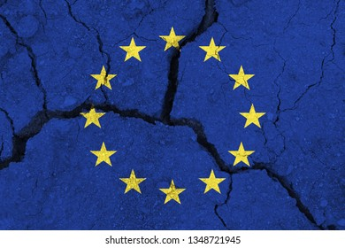 EU flag on the cracked earth. Europe flag. Earthquake or drought concept. brexit