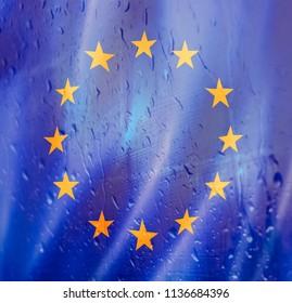 EU flag under sad rain drops: conceptual