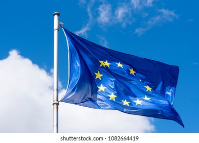 EU Flag waving against blue Sky