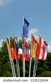 EU Flags of different Eurozone countries on blue sky