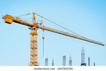 EU Lifting crane at development of modern skyscraper building.