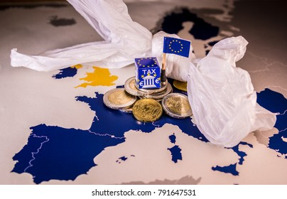 EU map with euro coins and a plastic bag symbolizing european plastic tax regulation.The European Union plans to propose a tax on plastic bags and packaging in the interest of the world's oceans