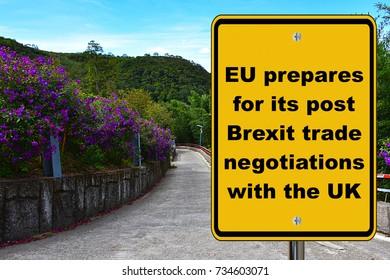 EU prepares for post Brexit trade negotiations, yellow road sign.