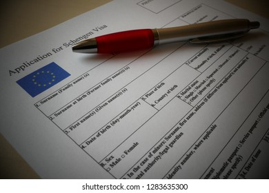 EU Schengen Visa application form with a pen for filling out. Document For applying to entry in the European Union.
