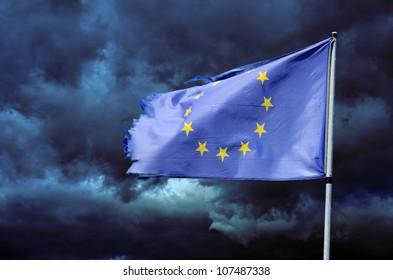 EU torn flag in stormy sky