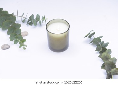 Eucalyptus Branches With Leaves candle with Candle in glass packaging decorated with stone