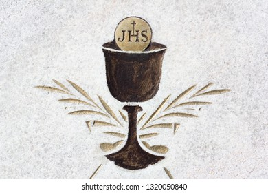 Eucharist - christian sacral ritual with cup, sacramental wine and bread. Icon and pictogram. JHS - Jesus Savior of Mankind