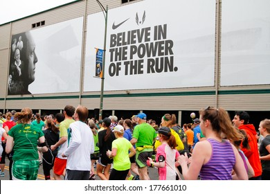 Eugene, OR - April 28: 2013 Eugene Marathon start with runners next to Historic Hayward Field at the University of Oregon with a Nike advertisement in the background on April 28, 2013 in Eugene, OR.