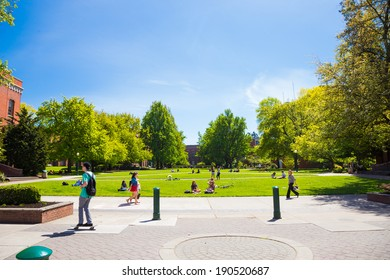 EUGENE, OR - APRIL 29, 2014: Grass plaza in front of the Lillis Business School at the University of Oregon with students relaxing and sitting.
