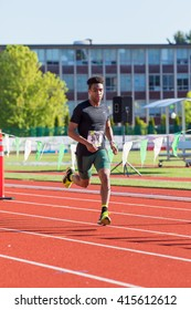 EUGENE, OR - MAY 1, 2016: Elite runner coming to the finish line for the half marathon distance at the 2016 Eugene Marathon, a Boston qualifying event.
