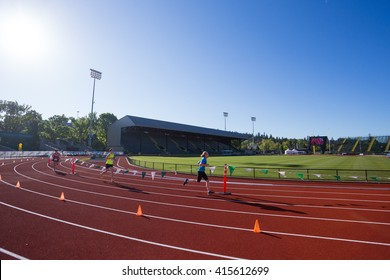 EUGENE, OR - MAY 1, 2016: Runner completing the final turn on the track at Hayward Field during the 2016 Eugene Marathon, a Boston qualifying event.