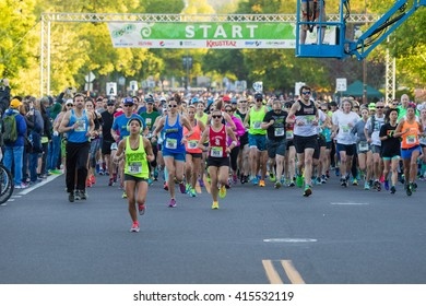 EUGENE, OR - MAY 1, 2016: Runners in a pack at the start of the 2016 Eugene Marathon, a Boston qualifying event.