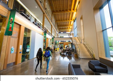 EUGENE, OR - MAY 17, 2017: Students study in the lobby of the Erb Memorial Union building on the University of Oregon campus.