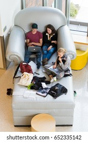 EUGENE, OR - MAY 17, 2017: Students study together on an oversized chair in the Erb Memorial Union building at the University of Oregon.