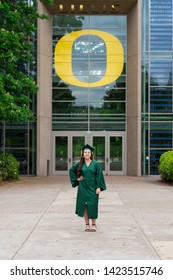 Eugene, OR - May 19, 2019: University of Oregon graduate Lacie Brown celebrates her graduation in cap and gown on campus in Eugene.