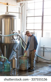 EUGENE, OR - NOVEMBER 4, 2015: Brewery owner Wes Gunderson brewing an IPA at the startup craft brewery Mancave Brewing.