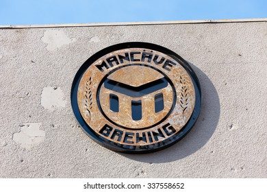 EUGENE, OR - NOVEMBER 4, 2015: Company logo on the outside of a building at the startup craft brewery Mancave Brewing.