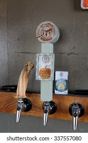 EUGENE, OR - NOVEMBER 4, 2015: Custom tap handle at the startup craft brewery Mancave Brewing.